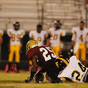 Ashley High School's Justin Foy is tackled by Fairmont High School's T.J. Bristow Friday September 5, 2014 in Wilmington, N.C. (Jason A. Frizzelle)