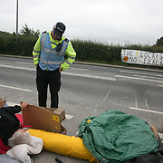 13 local activists locked themselves in specially made arm tubes to block the entrance to Quadrilla's drill site in New Preston Road, July 03 2017, Lancashire, United Kingdom. First police arrives, early morning. The 13 activists included 3 councillors; Julie Brickles, Miranda Cox and Gina Dowding and Nick Danby, Martin Porter, Jeanette Porter,  Michelle Martin, Louise Robinson,<br /> Alana McCullough, Nick Sheldrick, Cath Robinson, Barbara Cookson, Dan Huxley-Blyth. The blockade is a repsonse to the emmidiate drilling for shale gas, fracking, by the fracking company Quadrilla. Lancashire voted against permitting fracking but was over ruled by the conservative central Government. All the activists have been active in the struggle against fracking for years but this is their first direct action of peacefull protesting. Fracking is a highly contested way of extracting gas, it is risky to extract and damaging to the environment and is banned in parts of Europe . Lancashire has in the past experienced earth quakes blamed on fracking.