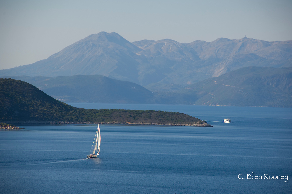 A sailboat off the coast of Ithaca and a view toward Kefalonia, The Ionian Islands,  Greece