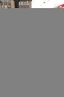 26 MAR 2004, BERLIN/GERMANY:<br /> Wolfgang Clement, SPD, Bundeswirtschaftsminister, spricht mit einem Megaphon zu Arbeitern aus der Zementindustrie, die im eine Resolution ueber die negativen Auswirkungen des Emissionshandels auf Wettbewerbsfaehigkeit und Arbeitsplatz übergeben haben, vor dem Bundesministerium fuer Wirtschaft und Arbeit<br /> IMAGE: 20040326-01-032<br /> KEYWORDS: Demo, Demostration, Megafon