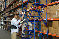 Men working in distribution warehouse