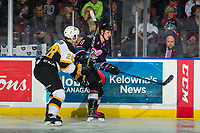 KELOWNA, CANADA - NOVEMBER 3: Baron Thompson #28 of the Brandon Wheat Kings checks Jack Cowell #8 of the Kelowna Rockets into the boards on November 3, 2018 at Prospera Place in Kelowna, British Columbia, Canada.  (Photo by Marissa Baecker/Shoot the Breeze)