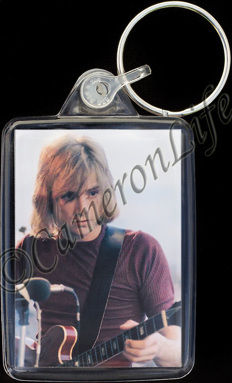 Justin Hayward - Key Fob with image approx. 35mm x 50mm from 1970 Isle of Wight Music Festival exhibition on the front. The reverse has an exclusive CameronLife  1970 IW festival design