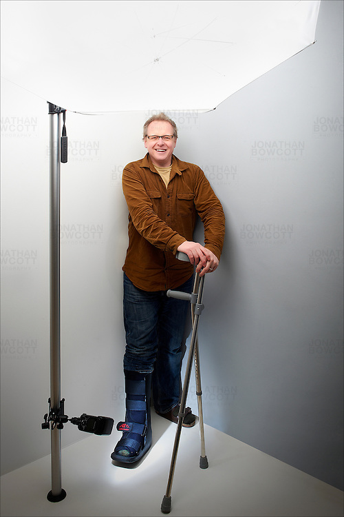 Image of Jonathan Bowcott with crutches and surgical boot. Taken in his Bristol studio, by his wife, after he arrived home from hospital.