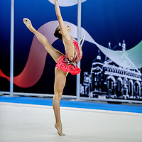 PADUA, ITALY - NOVEMBER 12 2016: Francesca Pellegrini of Raffaello Motto performs with hoop at the italian national rhythmic gymnastic championship. Her score in the apparatus is 15,900. Her team's score is 96,650 and ended up in fourth position.<br /> #SerieAdiritmica<br /> #ginnasticaritmica #rhythmicgymnastic #gymnast #sport #sportphotography