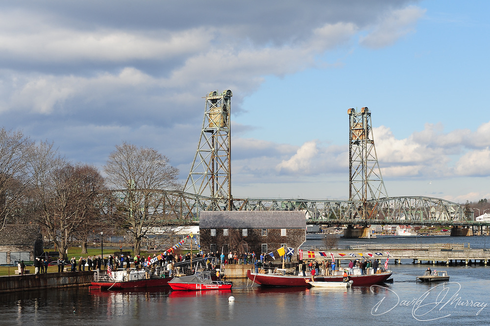 Piscataqua's maiden voyage... from Peirce Island boat ramp to Prescott Park. nears its end as she approaches the Capt. E.H. Adams, with Memorial Bridge in the background