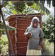 An African farmer harvests fruits in Lwala, a town in the North Kamagambo region of Kenya.