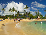 Tourists enjoy their fun at Poipu Beach, Koloa, Kauai, Hawaii, USA.