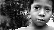A curious boys face. The village of Churoco, Darien Province, Panama.