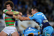 GOLD COAST, AUSTRALIA - JULY 27:  Matt King of the Rabbitohs is tackled during the round 20 NRL match between the Gold Coast Titans and the South Sydney Rabbitohs at Skilled Park on July 27, 2013 on the Gold Coast, Australia.  (Photo by Matt Roberts/Getty Images)