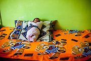 Emelia's one month old daughter Aneta sleeping in their new built house located at the Roma settlement Ostrovany.