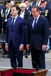 © Licensed to London News Pictures. 08/05/2015. LONDON, UK. Nick Clegg and Prime Minister David Cameron attending a service of remembrance at the Cenotaph in London marking the 70th anniversary of VE Day on Friday, 8 May 2015. Photo credit : Tolga Akmen/LNP