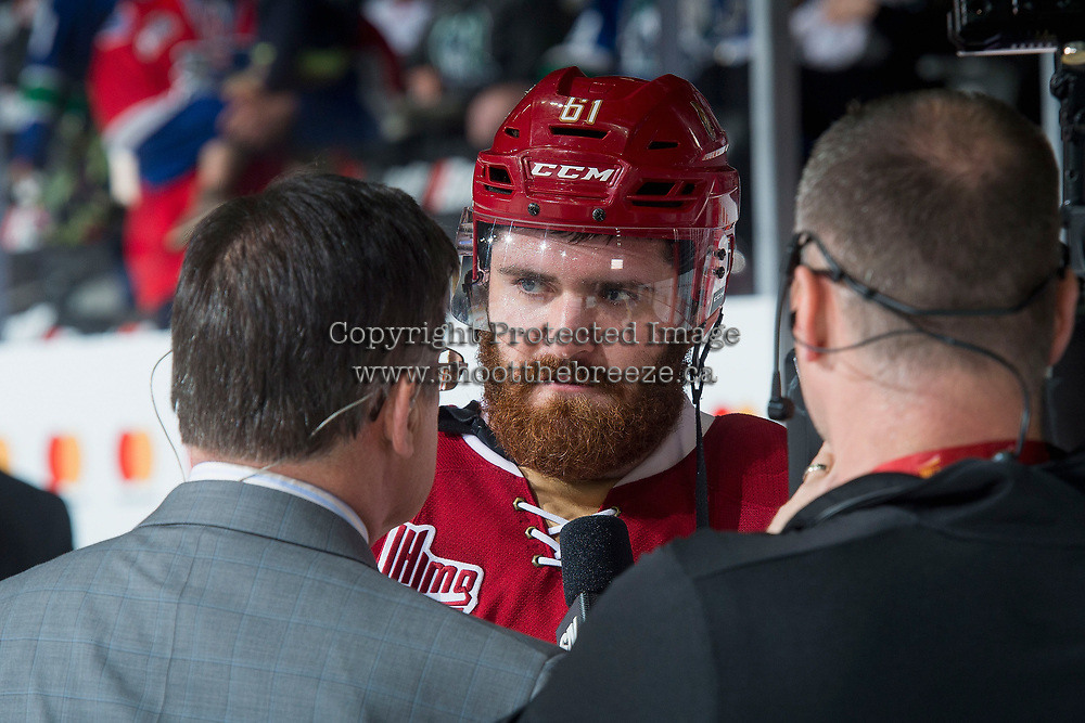 REGINA, SK - MAY 19: Liam Murphy #61 of Acadie-Bathurst Titan is interviewed by media at the end of the game and the OT win against the Swift Current Broncos at the Brandt Centre on May 19, 2018 in Regina, Canada. (Photo by Marissa Baecker/CHL Images)