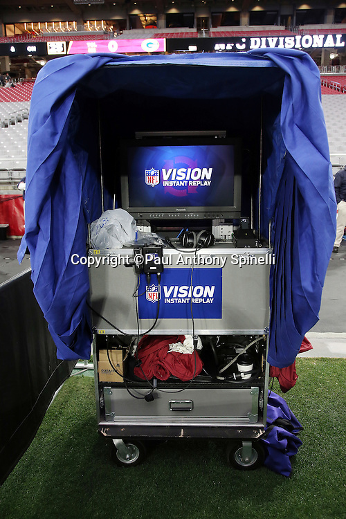 The instant replay cart stands ready with Vision instant replay logo appearing on the television screen before the Arizona Cardinals NFL NFC Divisional round playoff football game against the Green Bay Packers on Saturday, Jan. 16, 2016 in Glendale, Ariz. The Cardinals won the game in overtime 26-20. (©Paul Anthony Spinelli)