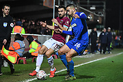 Wimbledon defender Rod McDonald (26) and West Ham United midfielder Robert Snodgrass (11) battle for the ball during the The FA Cup fourth round match between AFC Wimbledon and West Ham United at the Cherry Red Records Stadium, Kingston, England on 26 January 2019.