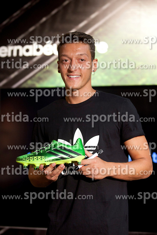 28.08.2013, Estadio Santiago Bernabeu, Madrid, ESP, Real Madrid, Ozil, im Bild The Real Madrid player Mesut Ozil, is presented as new image of the sports brand Adidas // during a presentation of new image of the sports brand Adidas at Bernabeu Store in Madrid, Spain 2013/08/28. EXPA Pictures &copy; 2013, PhotoCredit: EXPA/ Alterphotos/ Caro Marin<br /> <br /> ***** ATTENTION - OUT OF ESP and SUI *****