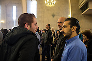 Sako, in blue  and Sarkis to his right, both Syrian-Armenians from Aleppo, celebrate Easter Sunday at the St Gregory Cathederal in Yerevan, Armenia, along with other friends from the community in Aleppo. There are an estimated 6,500 Syrian-Armenians currently living in Armenia. Bradley Secker, Sunday 31st March 2013. Yerevan, Armenia.