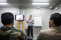 "VALLETTA, MALTA - 8 FEBRUARY 2017: Officials and petty officials of the Libyan Navy Coastguard and Libyan Navy attend a first-aid course held by an Belgian Military medic instructor in a container in the hangar of the San Giorgio, an amphibious transport dock of the Italian Navy, in Valetta, Malta, on Febuary 8th 2017.<br /> <br /> As a consequence of the April 2015 Libya migrant shipwrecks, the EU launched a military operation known as European Union Naval Force Mediterranean (EUNAVFOR Med), also known as Operation Sophia, with the aim of neutralising established refugee smuggling routes in the Mediterranean. The aim of this new operation launched by Europe is to undertake systematic efforts to identify, capture and dispose of vessels as well as enabling assets used or suspected of being used by migrant smugglers or traffickers. On 20 June 2016, the Council of the European Union extended Operation Sophia's mandate reinforcing it by supporting the training of the Libyan coastguard.<br /> Thus far, following EUNAVFOR MED operation Sophia's activities, 101 suspected smugglers and traffickers have been apprehended and transferred to the Italian<br /> authorities and 380 boats were removed from the criminal organizations' availability. The Operation has saved 32.081 migrants, among whom 1888 children.<br /> <br /> On February 2nd 2017 Italian Premier Paolo Gentiloni and Prime Minister of the U.N. backed Libyan government Fayez al-Serraj signed a memorandum of understanding on cooperation to combat illegal migration, human trafficking and contraband and on reinforcing the border between Libya and Italy. The following day, as EU leaders meet in Malta for a summit, European Council President Donald Tusk said after talks with Serraj, that ""it is time to close the (migrant) route from Libya to Italy"" and that ""the EU has shown it is able to close the routes of irregular migration, as it has done in the eastern Mediterranean.""  Tusk said the Central Mediterranean route was ""not sustainable either"