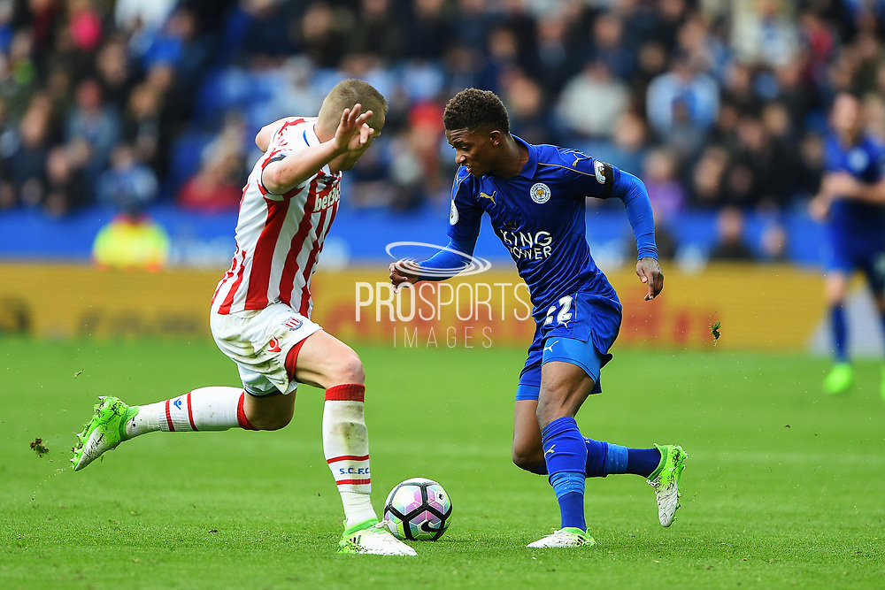 Leicester City midfielder Demarai Gray (22) battles with Stoke City defender Ryan Shawcross (17) during the Premier League match between Leicester City and Stoke City at the King Power Stadium, Leicester, England on 1 April 2017. Photo by Jon Hobley.