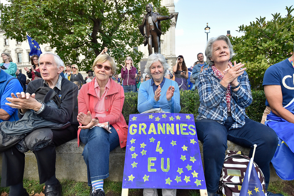 © Licensed to London News Pictures. 09/09/2017. London, UK. Anti-Brexit protesters sit in Parliament Square during the People's March for Europe rally campaigning for the UK's continued membership of the European Union. Photo credit : Stephen Chung/LNP