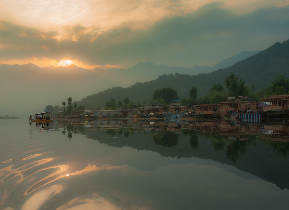 Reflecting mountains in Dal Lake at sunrise, Kashmir, India.