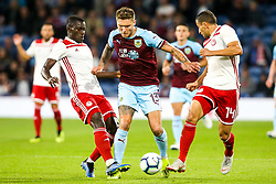 Jeff Hendrick of Burnley takes on Mady Camara of Olympiakos and Omar Elabdellaoui of Olympiakos - Mandatory by-line: Robbie Stephenson/JMP - 30/08/2018 - FOOTBALL - Turf Moor - Burnley, England - Burnley v Olympiakos - UEFA Europa League Play-offs second leg