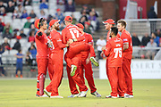 Lancashires Alex Davies congratulates Lancashires Matthew Parkinson during the Vitality T20 Blast North Group match between Lancashire Lightning and Birmingham Bears at the Emirates, Old Trafford, Manchester, United Kingdom on 10 August 2018.