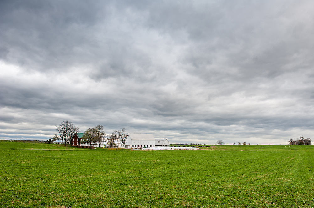 Dairy farm with storm brewing in the sky