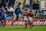 Souleymane Doukara (Leeds United) and Stephen Kelly (Rotherham United) go for the same bouncing ball during the EFL Sky Bet Championship match between Rotherham United and Leeds United at the New York Stadium, Rotherham, England on 26 November 2016. Photo by Mark P Doherty.