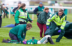 LIVERPOOL, ENGLAND - Thursday, April 6, 2017: Katie Walsh is treated after dismounting Distime after jumping The Chair, during Randox Health Foxhunters' Open Hunters' Chase (National Course) (Class 2) race on The Opening Day on Day One of the Aintree Grand National Festival 2017 at Aintree Racecourse. (Pic by David Rawcliffe/Propaganda)