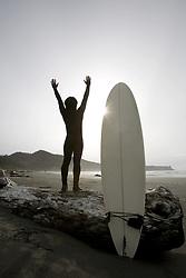 July 21, 2019 - Surfer Stretching On Beach (Credit Image: © Deddeda/Design Pics via ZUMA Wire)