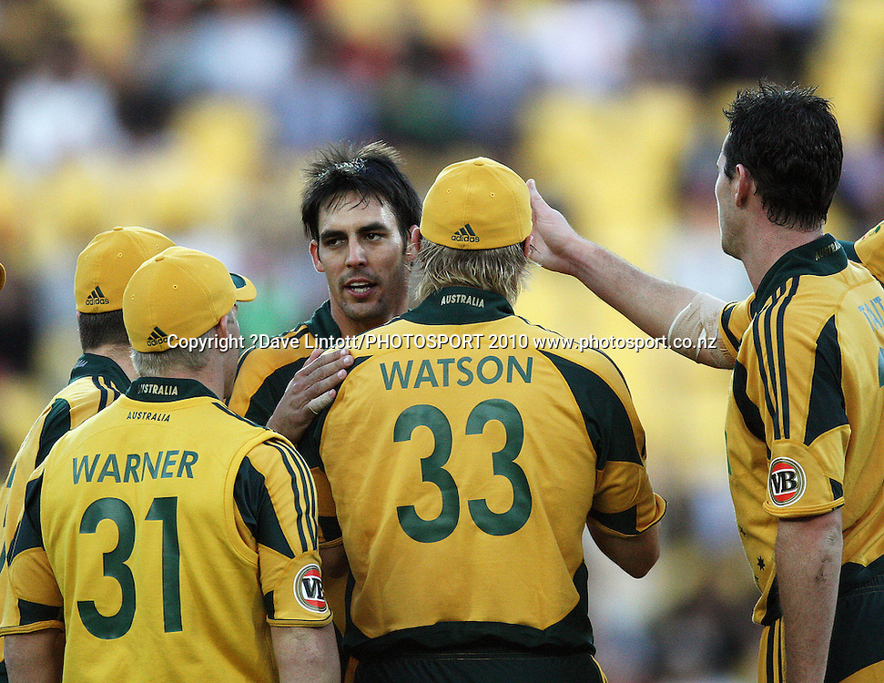 Mitchell Johnson congratulates Shane Watson for catching Martin Guptill.<br /> 1st Twenty20 cricket match - New Zealand v Australia at Westpac Stadium, Wellington. Friday, 26 February 2010. Photo: Dave Lintott/PHOTOSPORT