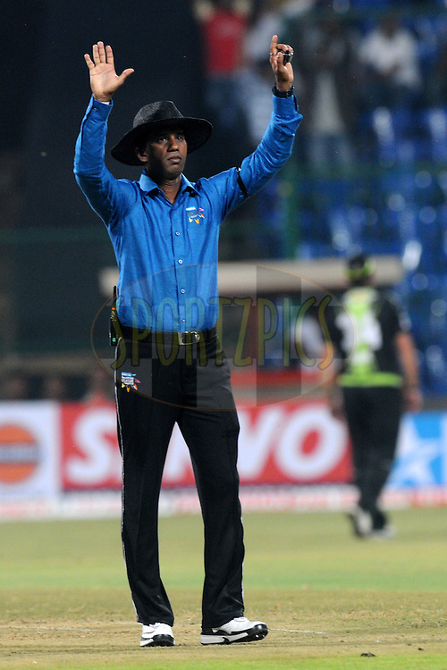 Field umpire Kumara Dharmsena signals a six during match 1 of the NOKIA Champions League T20 ( CLT20 )between the Royal Challengers Bangalore and the Warriors held at the  M.Chinnaswamy Stadium in Bangalore , Karnataka, India on the 23rd September 2011..Photo by Pal Pillai/BCCI/SPORTZPICS