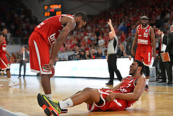 14.06.2015, Brose Arena, Bamberg, GER, Beko Basketball BL, Brose Baskets Bamberg vs FC Bayern Muenchen, Playoffs, Finale, 3. Spiel, im Bild Ryan Thompson (Brose Baskets Bamberg) liegt nach einem Zweikampf mit Schmerzen am Boden. Links: Bradley Wanamaker (Brose Baskets Bamberg). Hinten rechts: Dawan Robinson (Brose Baskets Bamberg) // during the Beko Basketball Bundes league Playoffs, final round, 3rd match between Brose Baskets Bamberg and FC Bayern Muenchen at the Brose Arena in Bamberg, Germany on 2015/06/14. EXPA Pictures &copy; 2015, PhotoCredit: EXPA/ Eibner-Pressefoto/ Merz<br /> <br /> *****ATTENTION - OUT of GER*****