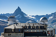 Gornergrat Kulm Hotel & restaurant was built from 1897-1907 at 3120 meters elevation, reached from Zermatt via the Gornergrat railway, in the Pennine/Valais Alps, Switzerland, Europe. The two tower domes were added in 1996 to enclose the KOSMA telescope and Gornergrat Infrared Telescope. The Gornergrat rack railway (GGB) takes you to a spectacular ridge (at 3135 m or 10,285 ft) between Gornergletscher and Findelgletscher, with views of more than twenty 4000-meter-high peaks, the highest being Dufourspitze (Monte Rosa massif), Liskamm, Matterhorn, Dom and Weisshorn. Gornergrat train, opened in 1898, climbs almost 1500 m or 4900 ft via Riffelalp and Riffelberg.