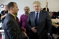 © Licensed to London News Pictures. 26/02/2013. London, UK. The Mayor of London, Boris Johnson, is seen at the opening of 'East End Manufacturing' in Bethnal Green, London today (26/02/2013). The mayor officially opened the East London clothing factory today and talked about his support for London based manufacturing. Photo credit: Matt Cetti-Roberts/LNP