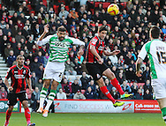 Picture by Tom Smith/Focus Images Ltd 07545141164<br /> 26/12/2013<br /> Andrew Surman (centre right) of Bournemouth and Liam Fontaine (left) of Yeovil Town both jump up to head the ball during the Sky Bet Championship match at the Goldsands Stadium, Bournemouth.