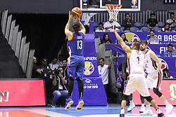 September 17, 2018 - Quezon City, NCR, Philippines - Marcio Lassiter (Blue) of the Philippines takes a three-point shot over Mohamed Hassan A Mohamed (White) of Qatar. (Credit Image: © Dennis Jerome S. Acosta/Pacific Press via ZUMA Wire)