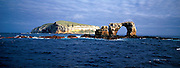 ECUADOR, GALAPAGOS sea arch off cliffs of Darwin Island