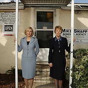 Jan 19 2007, Orlando, FL, USA:.Debbie and Sharon (light grey suit) Jallad from Accredited Surety..They pose outside of several of their Bail Bond clients and the Orange County Jail. ..Photo by Preston Mack / Redux