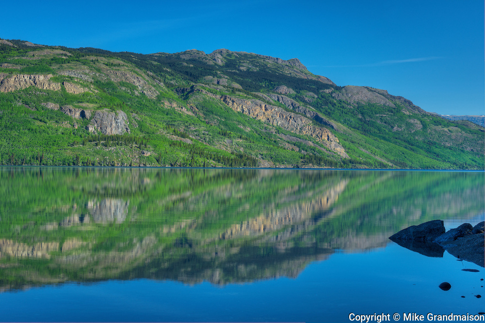 Reflection in Kinaskan Lake along the Stewart Cassiar Highway<br /> Along the Stewart Cassiar Highway<br /> British Columbia<br /> Canada
