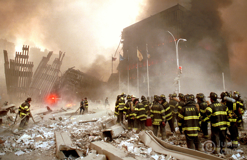 New York City firefighters gather at the site of the World Trade Center collapse.