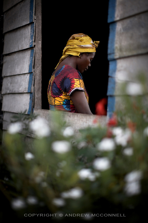 A 32 year-old woman waits for treatment at SOPROP (Solidarite Pour la Promotion Sociale et la Paix), a local NGO, in Kitchanga, North Kivu, DRC. The woman was raped by 2 CNDP soldiers on 5/1/08. Her husband has since left with their 4 children and she now lives with her mother. Sexual violence systematic in DRC with the brutality of attacks often leaving the victims with severe damage to reproductive organs, resulting in multiple fistulas and incontinence. According to the UN Population Fund an average of 1,100 rape cases are reported each month.