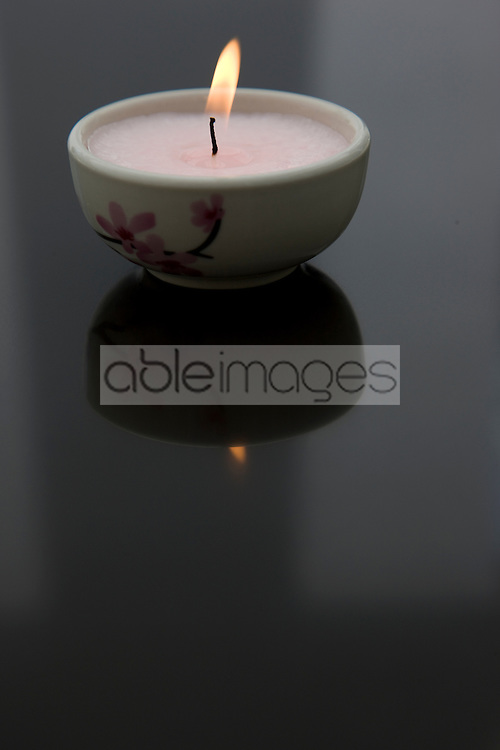 Burning pink tea light