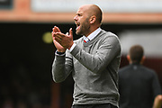 Neil MacFarlane, Manager of Kidderminster Harriers urges his team on during the Vanarama National League match between York City and Kidderminster Harriers at Bootham Crescent, York, England on 15 September 2018.