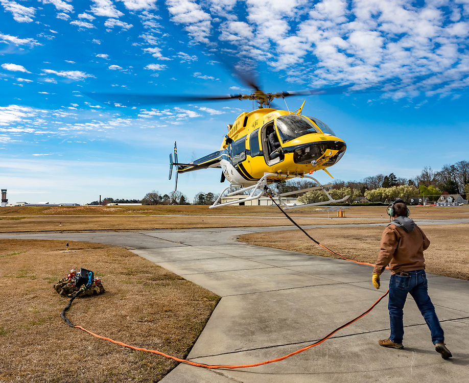Demonstration flight of the Vita Inclinata Load Stabilizing System (LSS) at Atlanta's Dekalb Peachtree Airport, during the 2019 Heli Expo