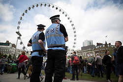 "© Licensed to London News Pictures . 23/05/2015 . Manchester , UK . Police Liaison officers in Piccadilly Gardens . A demonstration , organised by "" The People's Assembly "" , against austerity in Piccadilly Gardens in Central Manchester , attended by approximately 2000 people . Photo credit : Joel Goodman/LNP"