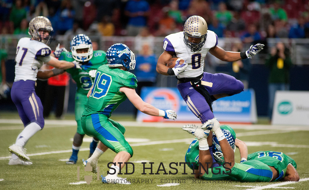 27 NOV. 2015 -- ST. LOUIS -- Christian Brothers College High School football player Tre Bryant (8) attempts to elude Blue Springs South High School defenders Robert Thomas (16), William Hughes (19) and Collin West (18) during the MSHSAA Show-Me Bowl Class 6 Championship at the Edward Jones Dome in St. Louis Friday, Nov. 27, 2015. Blue Springs topped CBC 37-28. Photo © copyright 2015 Sid Hastings.