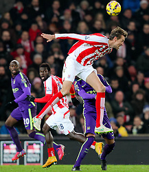 Stoke City's Peter Crouch wins a header - Photo mandatory by-line: Matt McNulty/JMP - Mobile: 07966 386802 - 11/02/2015 - SPORT - Football - Stoke - Britannia Stadium - Stoke City v Manchester City - Barclays Premier League