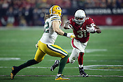 Arizona Cardinals rookie running back David Johnson (31) tries to avoid a tackle attempt by Green Bay Packers inside linebacker Clay Matthews (52) after catching a first quarter pass for no gain on the play during the NFL NFC Divisional round playoff football game against the Green Bay Packers on Saturday, Jan. 16, 2016 in Glendale, Ariz. The Cardinals won the game in overtime 26-20. (©Paul Anthony Spinelli)